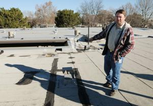 <p>Caldwell School District Maintenance Director Matt White stands on the roof of Syringa Middle School where multiple leaks in the roof have been patched.</p>