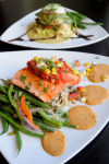 <p>A pepper salmon filet and a pesto margarita chicken at Twigs Bistro and Martini Bar in The Village at Meridian. Thursday, Jan. 9, 2014 Adam Eschbach/IPT</p>