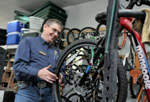 <p>Mike Waltermire, New Life Program manager with Lighthouse Rescue Mission, looks at a bike that will be donated at the Build-a-Bike program's workshop in Nampa.</p>
