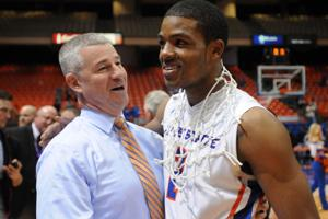 <p>Boise State head coach Leon Rice and Derrick Marks share a moment after beating Fresno State 71-52 to win a share of the Mountain West Conference Saturday, March 7, 2015 at taco Bell Arena in Boise. Adam Eschbach/IPT</p>
