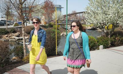 <p>Lanae McCormick, left, and Alli Hill, right, both of Caldwell, chat as they walk along Indian Creek Monday afternoon in downtown Caldwell.</p>