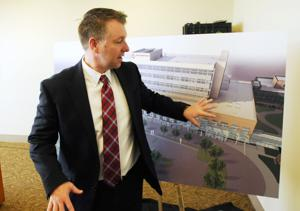 <p>Karl Keeler, CEO of Saint Alphonsus in Nampa and Ontario, looks over a rendering of the new Saint Alphonsus Health System hospital that is planned for the Nampa Heath Plaza after the Thursday afternoon announcement.</p>