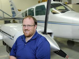 <p>Kevin Graville, director of operations at Valley Air Photos in Caldwell, stands next to a Cessna 320, one of their planes that takes aerial photographs.</p>