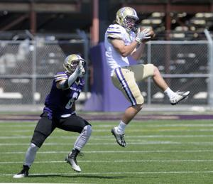 <p>Defensive back Nate Moore makes an interception during the College of Idaho Purple and Gold spring football game Saturday, May 2, 2015 at Simplot Stadium in Caldwell. Adam Eschbach/IPT</p>
