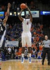 <p>Boise State's Thomas Bropleh hits a 3-pointer to send the game into double overtime against Nevada on Wednesday at Taco Bell Arena in Boise. Boise State lost 83-81 in double overtime in its final home game of the season.</p>