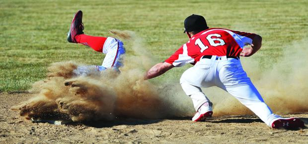 <p>Marsh Valley's Dustin Rowe is safe as American Falls' Boone Giulio (16) just misses the tag in the third inning at Magnuson Field in American Falls.</p>