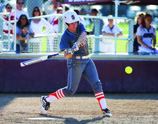 <p>Vicky Galasso swings at a pitch in a game earlier this season.</p>