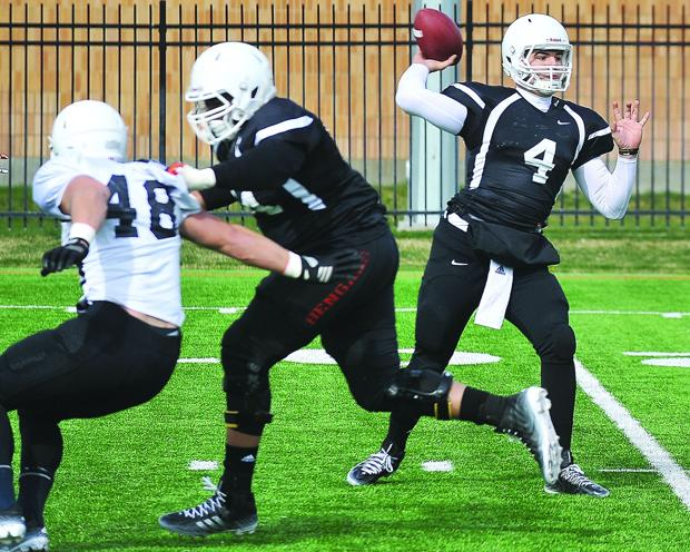 <p>Idaho State quarterback Tanner Gueller (4) passes while offensive lineman Terrence Carey blocks linebacker Kurt Karstetter (48) during a spring scrimmage Saturday, April 11, 2015, at the ICCU Practice Field.</p>