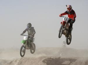 <p>Motocross racers hit a big jump on Saturday at the Phil Meader Courtesy Ford Enduro-X competition on Saturday at the Pocatello Motocross Park.</p>