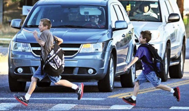 Parents Concerned Children Forced To Cross Busy Road To