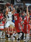 <p>Highland junior Connor Harding shoots over Madison defenders during their game Wednesday, Feb. 11, 2015, at Highland High School.</p>