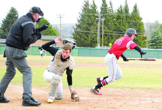 <p>Blackfoot catcher Jode Stephensen flips off his catcher's mask as a pitch sails by him during a game against Hillcrest on Monday at Blackfoot High School.</p>