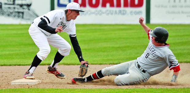 <p>Highland shortstop Mason Foltz (5) tags Hillcrest's Casey Pack at second base during their game Friday, April 24, 2015, at Halliwell Park.</p><p></p>