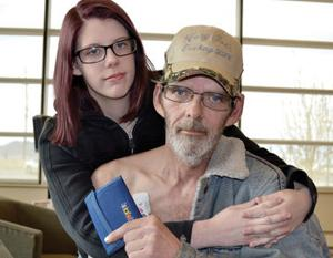 <p>Kelsey Angley gives her father, Frank, a hug at the Portneuf Medical Center on Saturday after he suffered a heart attack and had money from his wallet stolen Friday afternoon in Pocatello.</p><p></p>