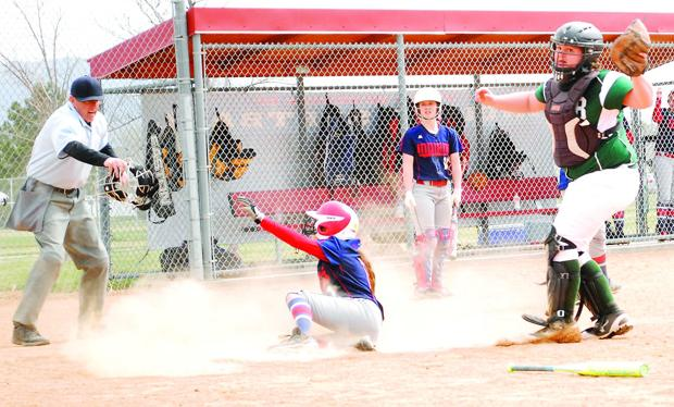 <p>Pocatello runner Mariah Madrid gets tagged out at home plate by Bonneville's Dani Bybee in their second game of a doubleheader Saturday at OK Ward Park.</p>
