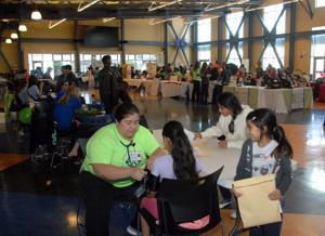 Health Fairs were held in Livermore and in Dublin this year. The fairs are designed to ensure that all Tri-Valley students have access to the state-mandated medical, vision and dental screenings necessary to register for school. Physicals - including immunizations, blood pressure readings, and height and weight measurements - were provided, along with linkages to medical services and information about health-care enrollment. There are no fees charged. Physicians, specialists, dentists, nurses and nursing students, health technicians, and lay volunteers volunteer their time. The Tri-Valley Health Fairs are funded by Measure A dollars and the sponsorships of partners, including Stanford Health Care - ValleyCare, Axis Community Health, Kaiser Permanente, and John Muir Health. The photos were taken at the Dublin Health Fair (Photos - Doug Jorgensen).