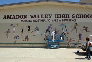 Class of 2015 Amador Valley High School seniors Chase Barkdull and Chris Goldhawk (Don Squad Organization), had a vision to create a 63 foot by 11 foot sports mural on campus to promote school spirit and pride to the students and staff. Bardull and Goldhawk contracted local mural artist Victoria Miraglio (Victoria Miraglio Murals) to develop and bring their vision to life. Amber Carrion, class advisor, spent many hours working on the project along with the students and artists to make this project happen. Miraglio in collaboration with Paul Benetti worked on the massive mural for almost a month. The painting includes athletes representing 16 different sports. Pictured working on the mural are Paul Benetti and Victoria Miraglio (Photos - Doug Jorgensen).