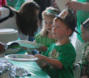 One young man held out his plate for a serving of green pancakes last Saturday, March 14th, during the annual Alameda County Firefighters Local 55 Pancake Breakfast (Photos - Doug Jorgensen).