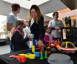 Sandia National Laboratories hosted a 60th anniversary celebration at the Bankhead Theater in Livermore. In the photo, visitors are looking a display of items printed using a 3-D printer (Photos - Doug Jorgensen)