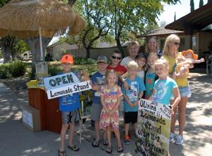 Funds raised at a lemonade stand in Livermore will be taken to Vacation Bible School. Kids attending the school collect money to give to a selected cause. The neighborhood kids got together to set up the stand on Olivina Avenue. In front are Lily and Shiloh; right behind them are Sean, Logan, and Matthew; in the third row are Ryan, Emma, and Mariah, in the back row are Karen, Sarah, and Cali with Melissa (Photos - Doug Jorgensen).
