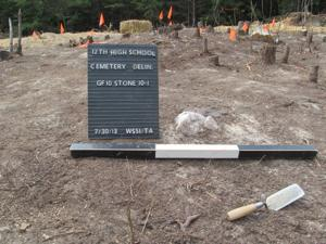 Graves at high school site