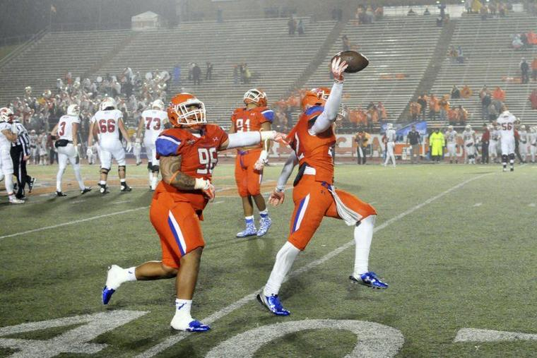 (Joshua Yates/The Huntsville Item) Sam Houston State senior linebacker Tristan Eche, right, celebrates with Sione Latu after recovering a fumble in the final minute of Saturday's 42-39 victory over Southern Utah in the first round of the NCAA Football Championship Subdivision playoffs on a rainy night at Bowers Stadium.