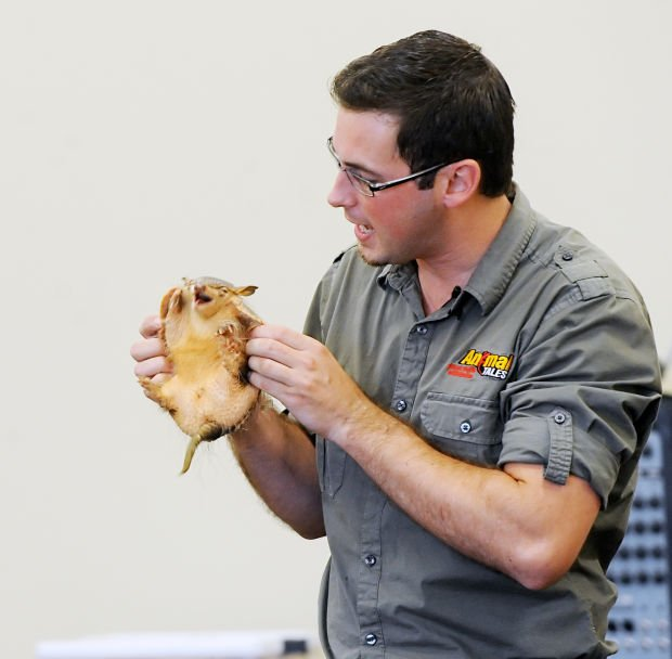 John Ham of Animal Tales holds a Screaming Hairy Armadillo