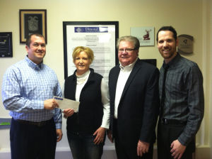 Camp New Hope receives donation from Dimond Bros. Insurance, LLC