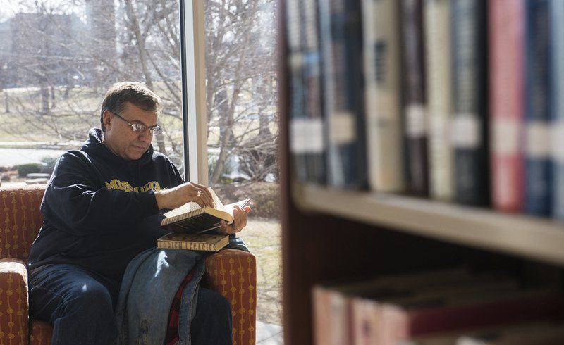 Don Smith has plenty of light on the subject in a corner last week at Carthage Public Library. GLOBE | ROGER NOMER
