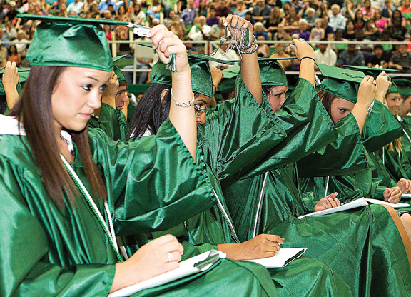 Students move their tassels: From left, Emma Sparkman, Rosario Tacam, Joanie Word and Kirstyn Douglas.