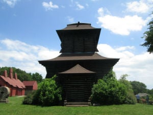 """<p>The """"technocratic cathedral"""" on the grounds of Boothe Memorial Park in Stratford was designed by David and Stephen Boothe. Made of stacked California redwood, the imposing structure is one of many the brothers built or had moved to their family homestead in the early 20th century.</p>"""