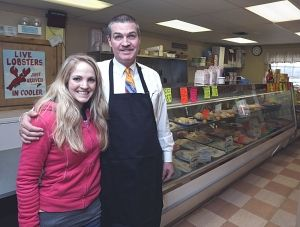 <p>Charles Ballad, new owner of Charlie's Fresh Catch on Route 83 in Vernon and his daughter, Brooke Ballard.  (Jared Ramsdell / Journal Inquirer)</p>