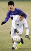Photos: Grand Island vs. Northeast boys soccer, 3.26.15