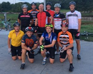 Cindy Lange-Kubick: Pete Ricketts on a road bike with an assist from the chain gang