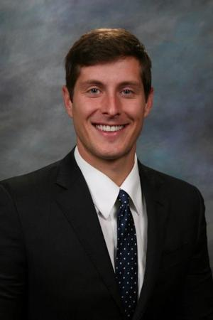 Law firm adds attorney