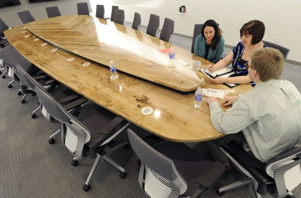 Wood cut from state fair park trees crafted into table for Table 52 parking