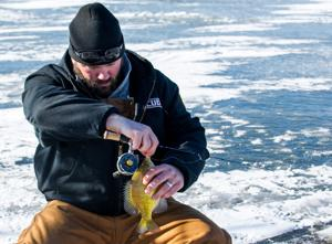 Despite winter weather, good turnout at ice fishing clinic