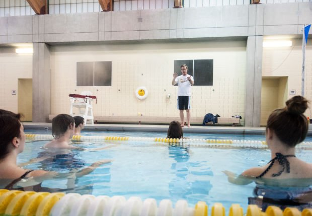 Nwu students learning music conducting in the pool local education for Cochrane pool swimming lessons