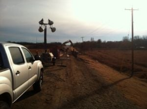 Soil shifting drawing out Highway 164 road construction
