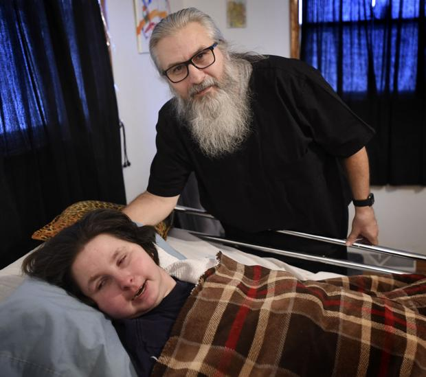 Father dedicates life to caring for his disabled daughter