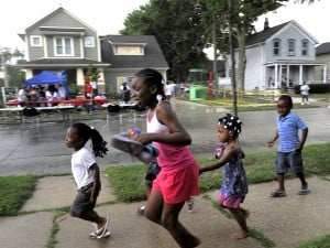 Children run for cover during the National Night Out event on the 1100 block ...