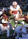 Minnesota run over in 12th straight loss to Wisconsin, 31-21