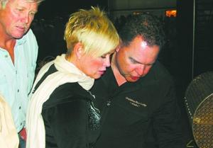 Country singer Lorrie Morgan checks out an item
