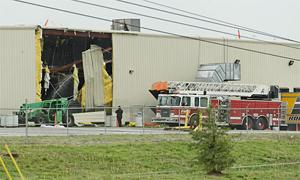 Heavy winds damage factory building