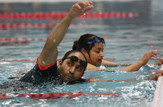 Teaching adult to swim