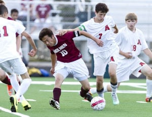 Photos: Arcadia vs. Holmen Boys Soccer (8/19/14)