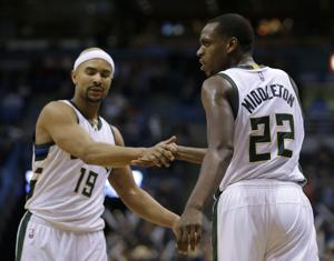 Middleton finds magic against Wizards