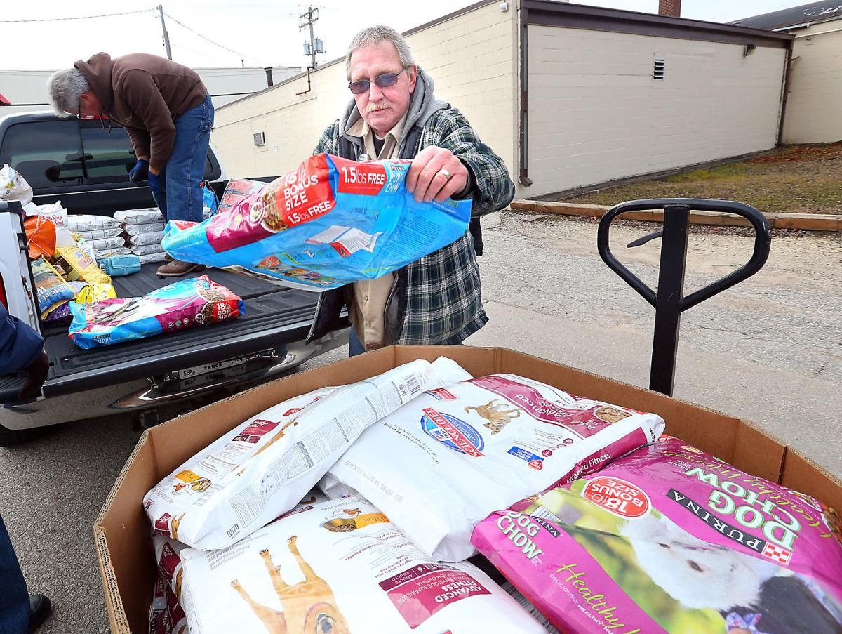 pet clinic collects 3 700 pounds of food for wafer clients