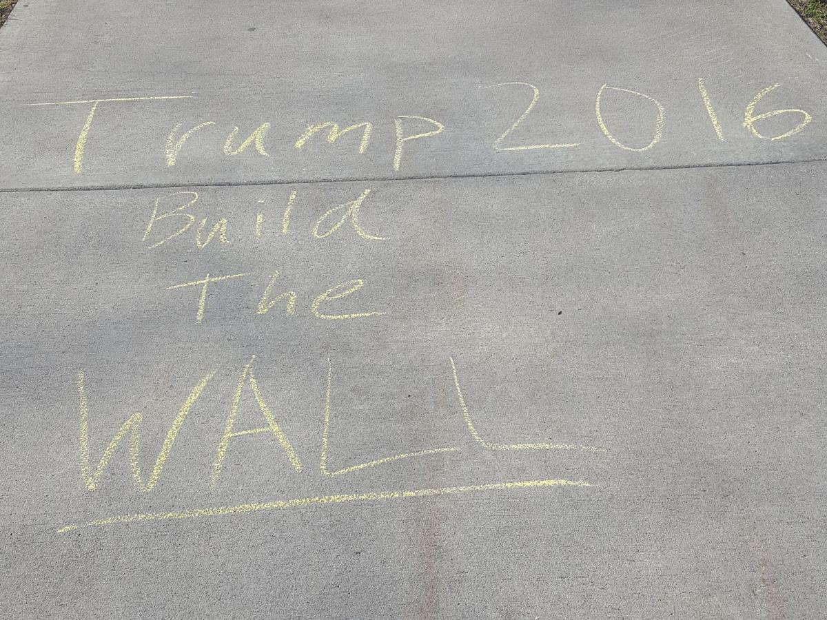 sidewalk messages result in speech dust up at uw la crosse build the wall uw l graffiti