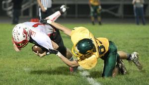 Gridiron Grit: Mel-Min tops Cards for fifth straight win